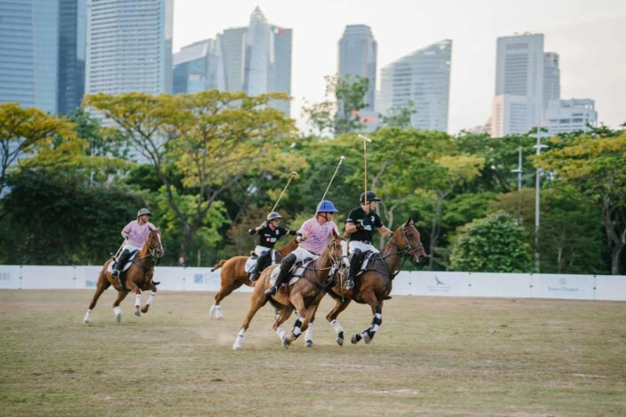 men riding horses about to play polo