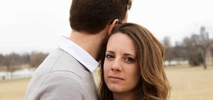 Couple hugging while facing different directions