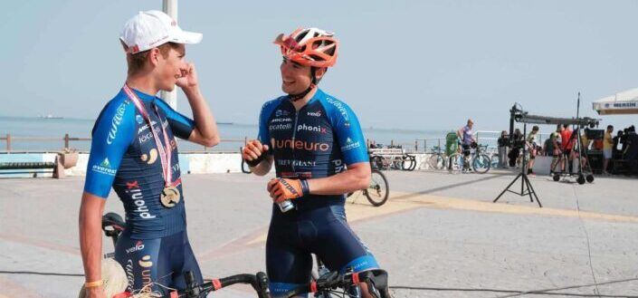 Two cyclists taking a break and talking