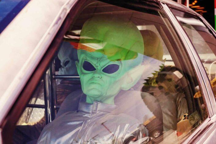 An alien inside a car