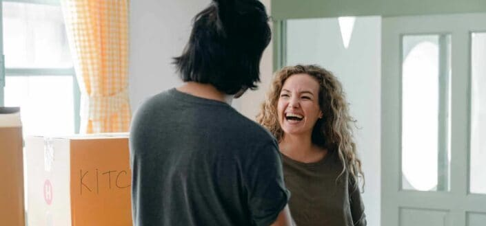 A woman happily laughing with her man.