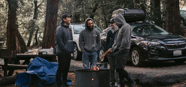 Friends on a camping within the woods