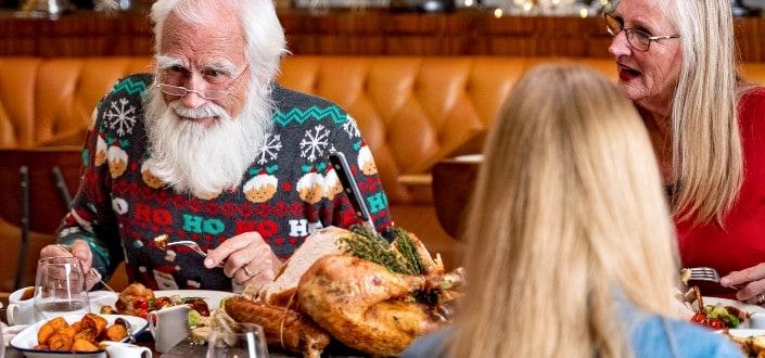 Old folks enjoying a Thanksgiving meal