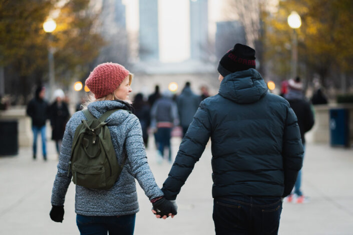 Couple having fun and holding hands while walking.