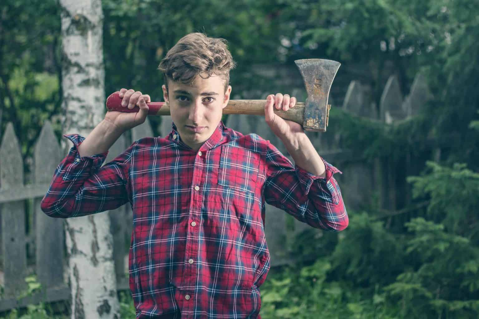 Young man holding an axe