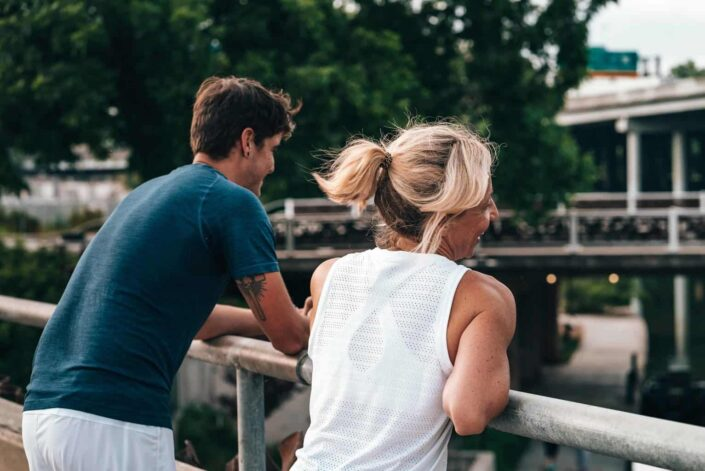 Couple hanging out on a bridge