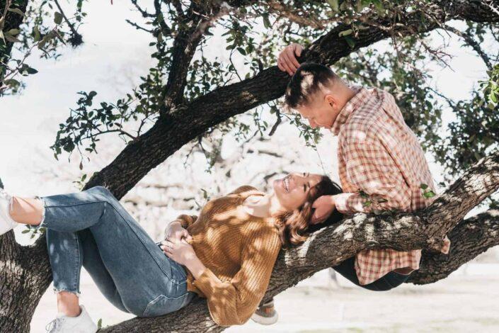 Couple cuddling on the tree