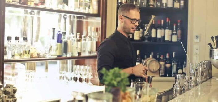 Bartender mixing cocktails on the counter