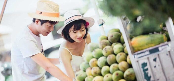 woman picking fruits with her boyfriend