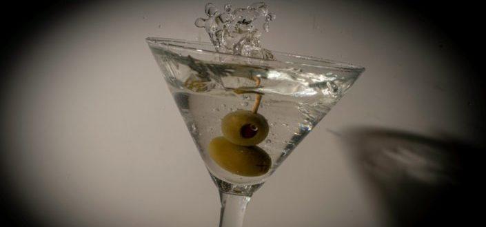 clear cocktail glass with orange liquid.jpg