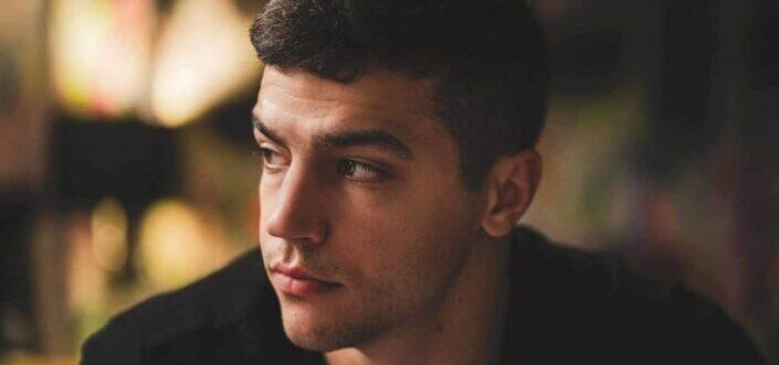 A serious face young man looking far away