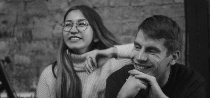 grayscale photo of happy couple