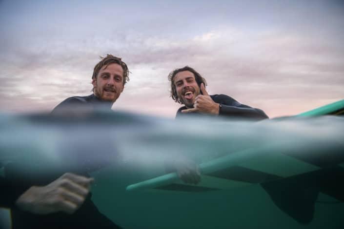 Two men looking at camera