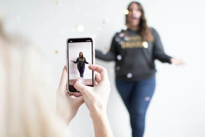Woman taking a photo of her friend