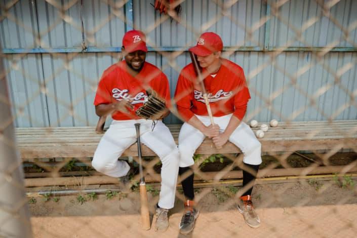 Diverse baseball players sitting