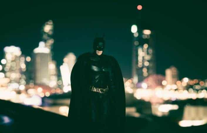 Batman standing on a top of a building