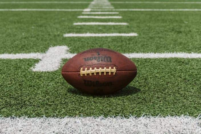 player on the football team usually throws the football