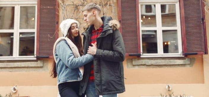 Sweet couple standing outside