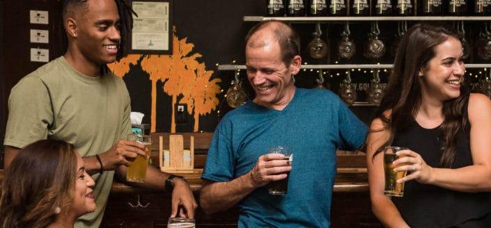 Friends enjoying beer on a cozy bar