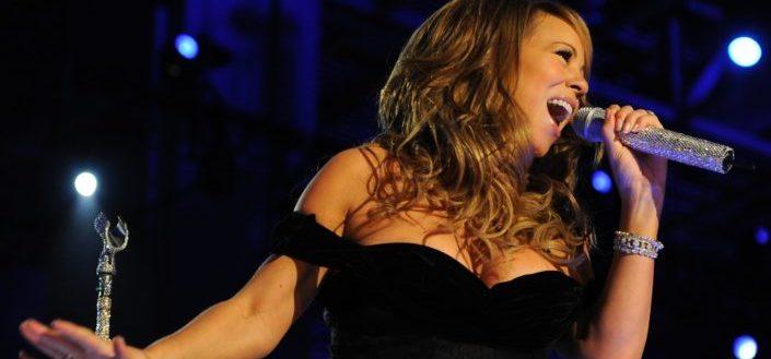 Mariah Carey singing at night