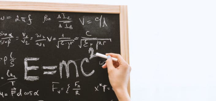 Math formulas written in a chalkboard