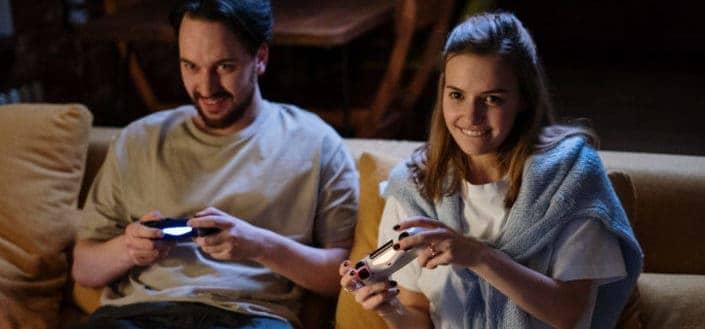 Couple having fun playing video games