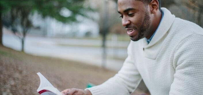 Man delightfully reading a book.