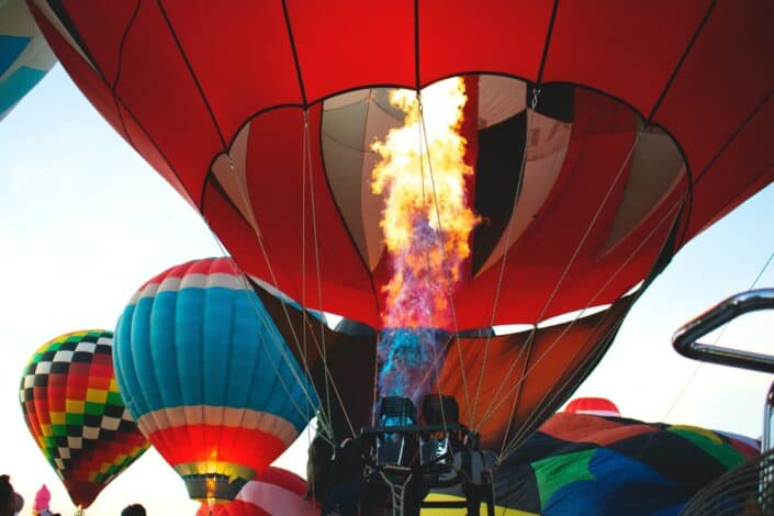 red hot air balloon being fired up