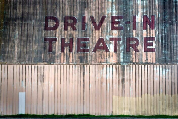 old painted sign of a drive-in theatre