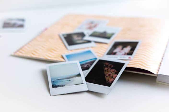 polaroid pictures on a scrapbook