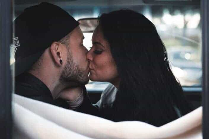 couple kissing inside a car