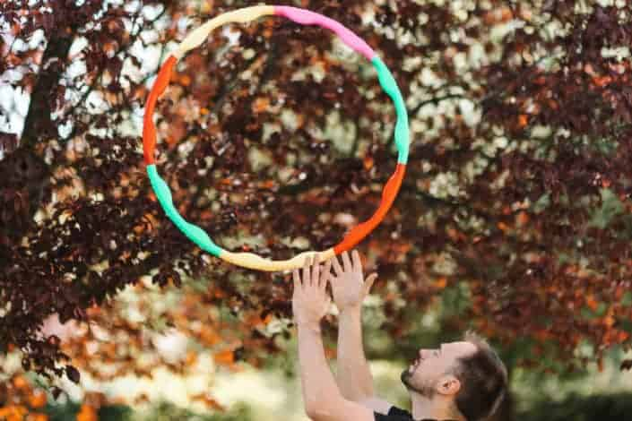 funny dares for guys - Pretend you're spinning a hula hoop around your waist for 5 minutes, without laughing or interrupting the game.