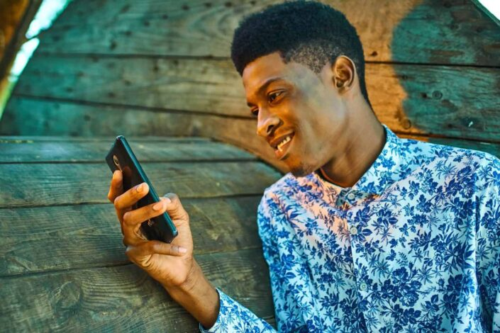 An amused guy reading a text message.