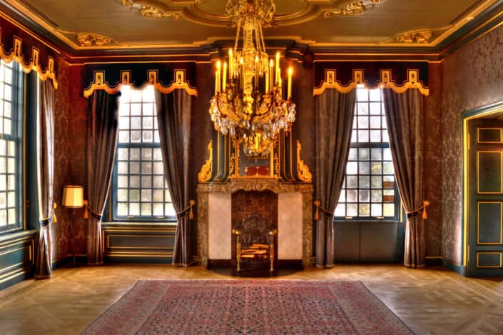 an empty room with chandelier