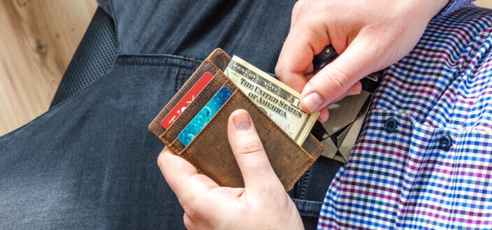 man pulling bills from his wallet