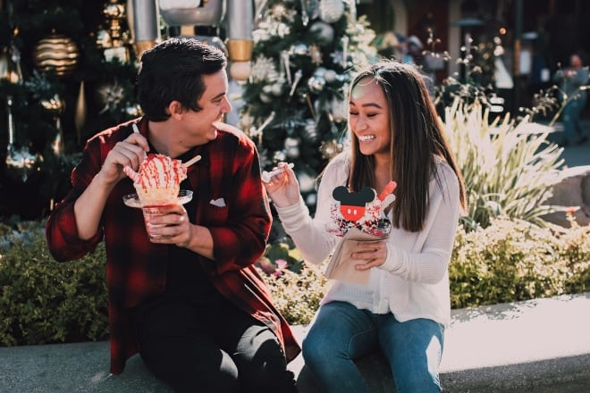 a couple laughing while eating their snacks - date questions