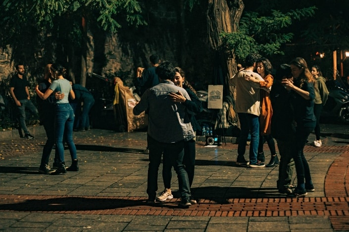 people dancing with their partners in an open area