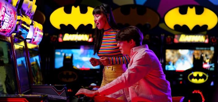 happy man and woman playing at an arcade