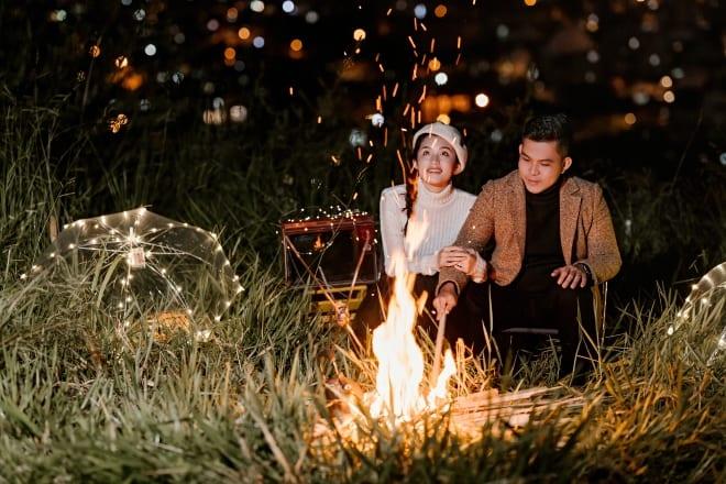 couple by bonfire