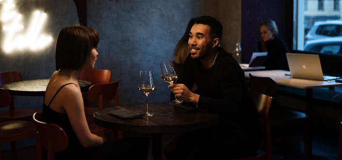 couple drinking champagne while talking