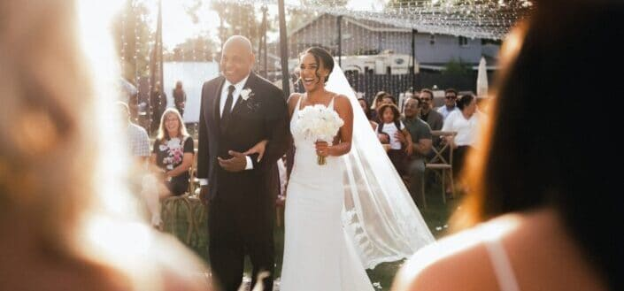 Father of bride bringing his daughter to the altar