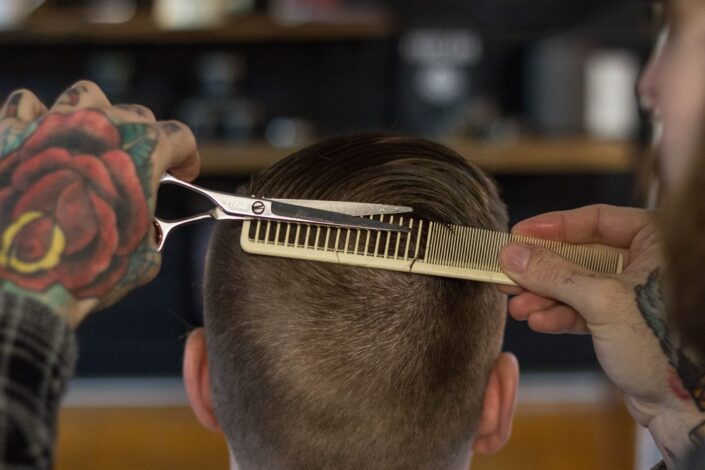 person doing the haircut carefully