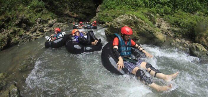 group of people having an outdoor water adventure