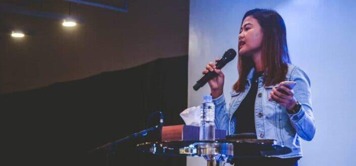 woman speaking on a podium
