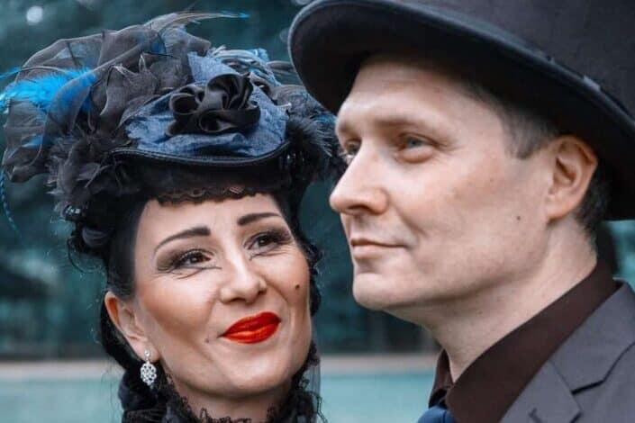 man and woman in victorian attire