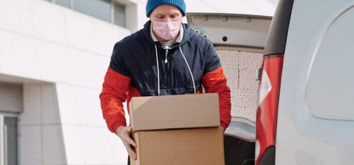 a courier employee carrying boxes