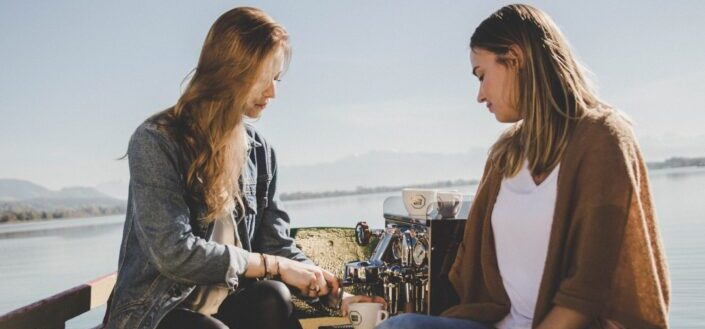 two women on boat with espresso machine