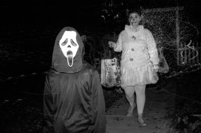 Halloween costume of ghost and scary clown.
