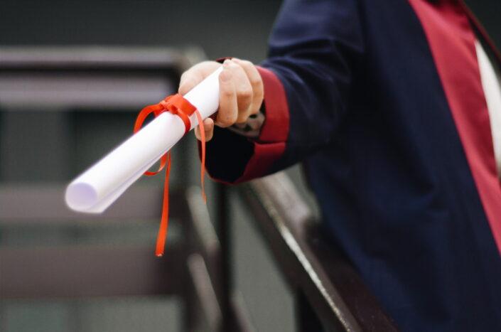 Man handing diploma