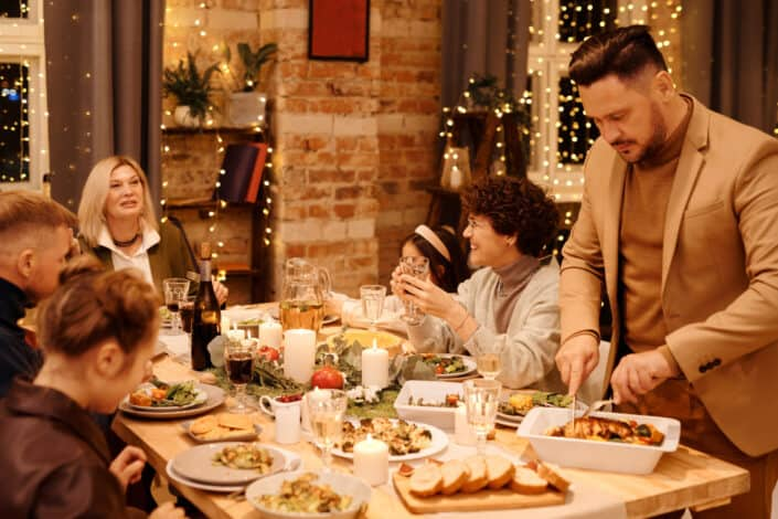 a family laughing together over dinner